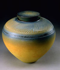 lidded yellow carved vessel