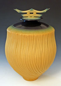 lidded yellow tall carved vessel