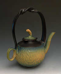 yellow carved teapot